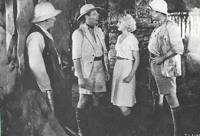 Edward Woods در صحنه فیلم سینمایی Tarzan the Fearless به همراه Philo McCullough، E. Alyn Warren و Julie Bishop