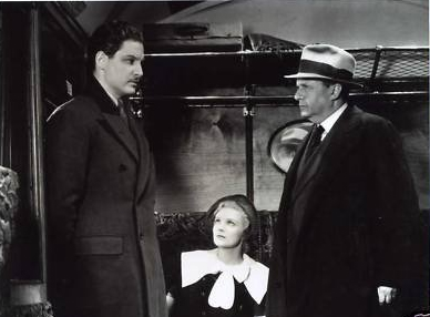 Robert Donat در صحنه فیلم سینمایی سی و نه پله به همراه Madeleine Carroll