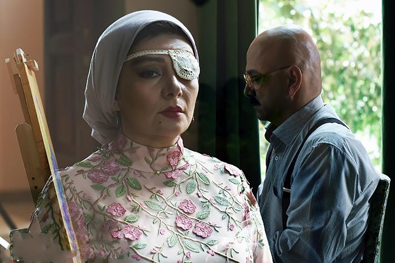 هنگامه قاضیانی و حبیب رضایی در فیلم سینمایی یک قناری یک کلاغ
