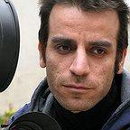 تصویری از شهرام مکری، نویسنده و کارگردان سینما و تلویزیون در پشت صحنه یکی از آثارش